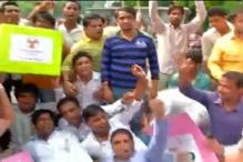 Youth Congress workers protest outside BJP headquarter in Delhi