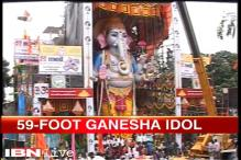 Thousands of devotees gather to worship 59 feet tall Ganesha idol in Hyderabad