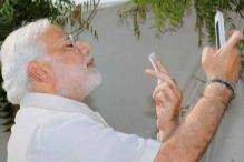 Gujarat HC admits plea against Modi for defying poll code of conduct, clicking selfie with BJP's lotus