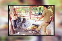 Pictures of UP cop breaking old man's typewriter goes viral, government suspends him