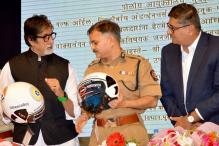 Amitabh Bachchan distributes helmets to Mumbai Traffic Police at a road safety event