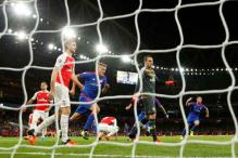 Arsenal's Champions League hopes hit by Olympiakos defeat