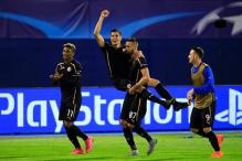 Champions League: Dinamo Zagreb beat 10-man Arsenal 2-1