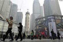 China revises down 2014 GDP growth to 7.3% from 7.4%