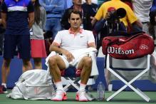 Roger Federer downed by Isner in Paris Masters