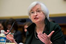 US Fed Reserve holds key rate steady, eyes two hikes later this year