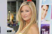 My first pair of heels were bright red pumps: Kate Hudson