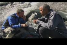 Obama appears on reality show, eats raw fish left behind by bear