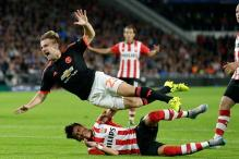 PSV's Hector Moreno offers best wishes after breaking Luke Shaw's leg
