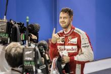 Ferrari's Sebastian Vettel takes pole position for Singapore Grand Prix