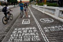 Thailand gets its first dedicated 'mobile phone lane' for pedestrians