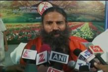 Ramdev flays Shah Rukh's intolerance remark, asks him to make a draft of money earned post Padma award