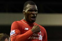 Liverpool's Christian Benteke to miss Bournemouth tie with knee injury