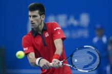 Nadal stutters to victory, Djokovic on fire at China Open