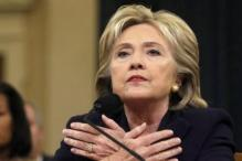 Hillary Clinton deflects harsh Republican criticism of her handling of 2012 Benghazi attack in a testy 11-hour hearing