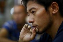 Rough weather forces Japanese climber with no fingers to abandon Everest bid
