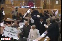 Opposition MLAs enter well of J&K Assembly, climb on tables over beef ban