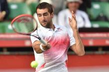 Marin Cilic saves match point before defeating Chinese wild card at Shanghai Masters