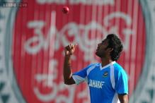 Bangladesh's pacer Hossain surrenders in court to face charges
