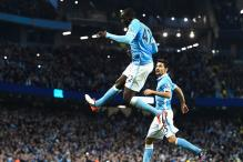 Yaya Toure's late penalty gives Manchester City 2-1 win against Norwich