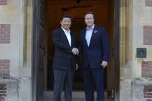 David Cameron takes Xi Jinping to the pub for fish and chips