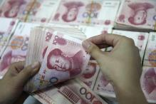 Chinese yuan weakens against US dollar for 8th day, lowest in month