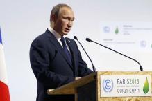 Putin snubs Erdogan in Paris as pilot's body returns to Russia