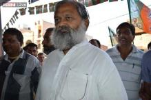 Haryana Minister Anil Vij walks out after woman SP refuses to leave on his command
