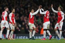 Sanchez double helps keep Arsenal's hopes alive in Champions League