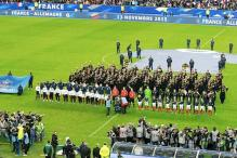 Paris Attacks: Football fans sing French national anthem during evacuation