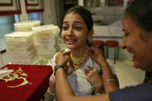 Gold languishes around 2010 low on US rate hike bets