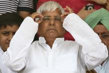 'Embarrassed' after his son fumbled, Lalu says Modi too misread his oath