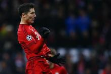 Bayern crush Olympiakos to book knockout place in Champions League
