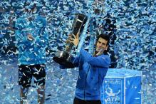 Novak Djokovic ends year on high with ATP Finals win over Roger Federer