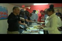 Watch: Obamas serve thanksgiving dinner to homeless