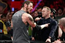 Wayne Rooney slaps wrestler Wade Barrett during WWE Raw event