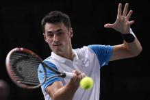 Dominic Thiem, Bernard Tomic advance at Paris Masters