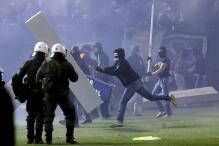 Athens derby between Olympiacos and Panathinaikos called off after violent clashes