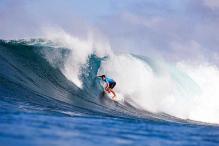 Surfer Adriano de Souza rides 'Brazilian wave' to world title