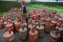OilMin hands over Guinness certificate for LPG subsidy to Modi