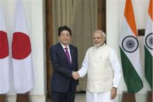 India-Japan sign bilateral agreements, Modi welcomes Abe's support for APEC membership to India