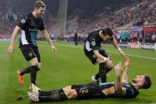 Giroud scores hat-trick as Arsenal beat Olympiakos 3-0 to qualify for last 16 of Champions League