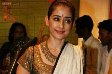 For which Southern film has Manisha Koirala postponed Rajkumar Santoshi's project?