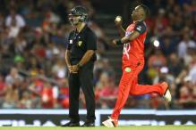 Umpire officiates wearing helmet for protection in a Big Bash T20 match
