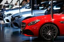Automakers go beyond luxury; seek software expertise for premium cars