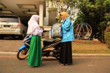Women motorbike drivers offer female-only riding service in Jakarta