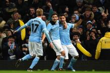 Sergio Aguero heads Manchester City into League Cup final