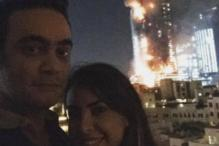 This couple posts a selfie with the burning Dubai hotel in the background; slammed by Twitteratti
