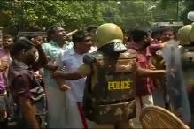 Stone pelting, tear gas shelling in Kerala as CM Chandy moves HC in solar scam