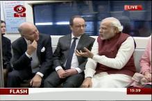 Hollande, Modi take 'eco friendly' metro ride to Gurgaon